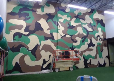 camouflage mural on cinder block wall in Gainesville, VA