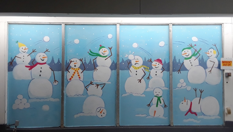 Whimsical snowman mural on a window in Sterling, VA