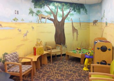Safari mural with leppard giraffes and zebras in Loudoun medical waiting area in Dulles, VA