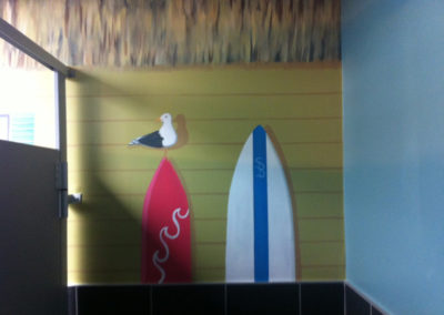 beach mural with surfboards and seagull in Northern VA