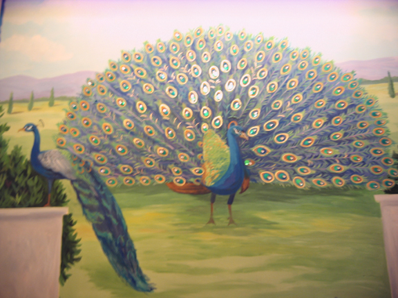 in progress peacock mural with gold and jewels in Fairfax VA