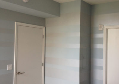 Horizontal painted stripes in blue and silver for bedroom