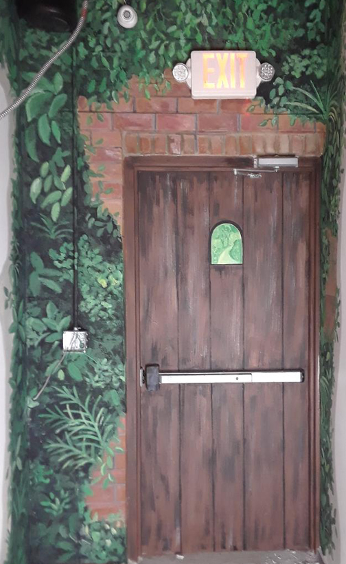 faux wooden mural on metal door