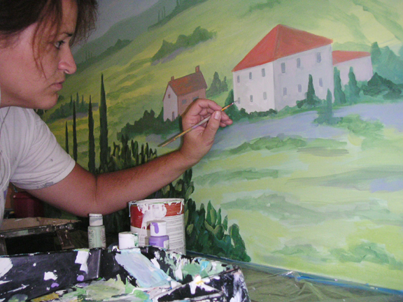 Amy Tubbs painting mural of rural house in the country